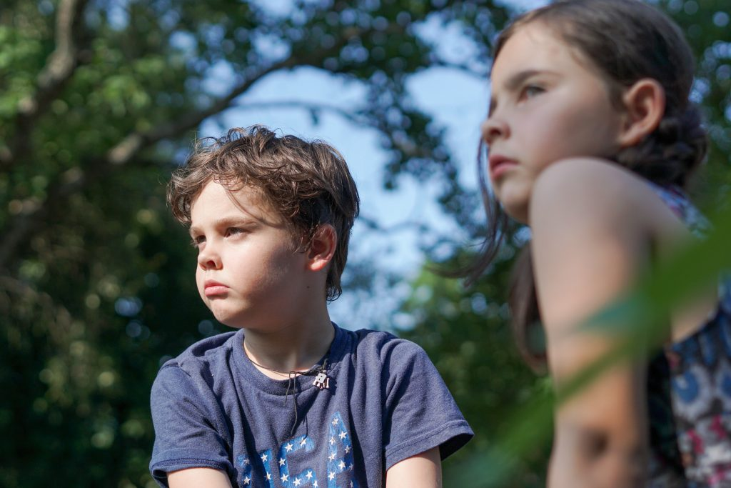 Two children making a life choice not to speak to each other