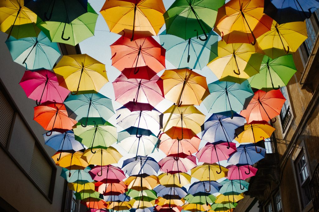 Brightly coloured umbrella's protecting you from the truth. Not what a great therapist does.