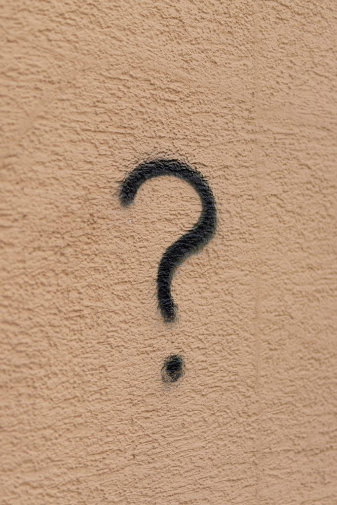 Wall with a question mark graffitied on why leave your job