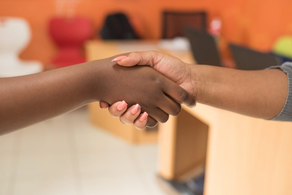 Handshake between two people after building trust ,whilst being in therapy