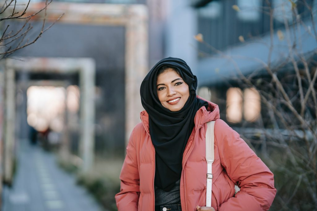 Asian woman with a headscarf confident in knowing what to write about