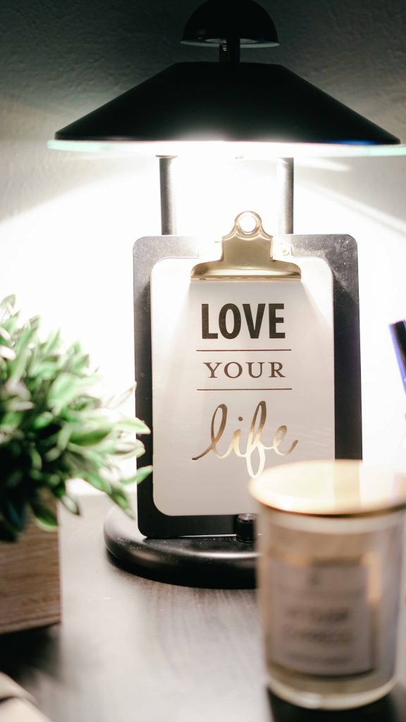 A clipboard with the words love your life to show how you'll feel after starting a blog following a year in therapy