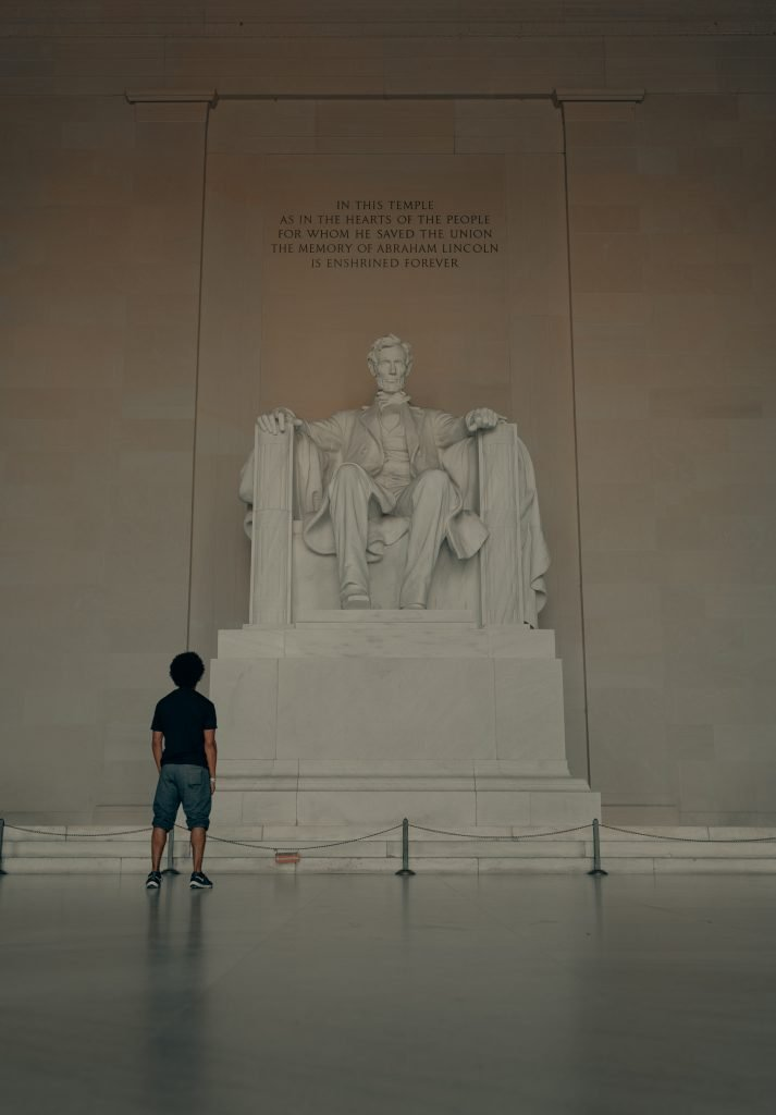 Man admiring a statue of Abraham Lincoln and his qualities to find his passion career