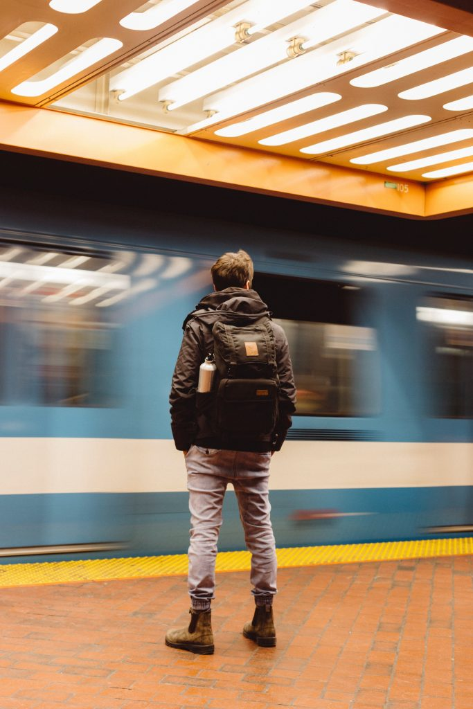 Man on a platform with a train going by to discover what travel arrangements he wants in his life passion. if any