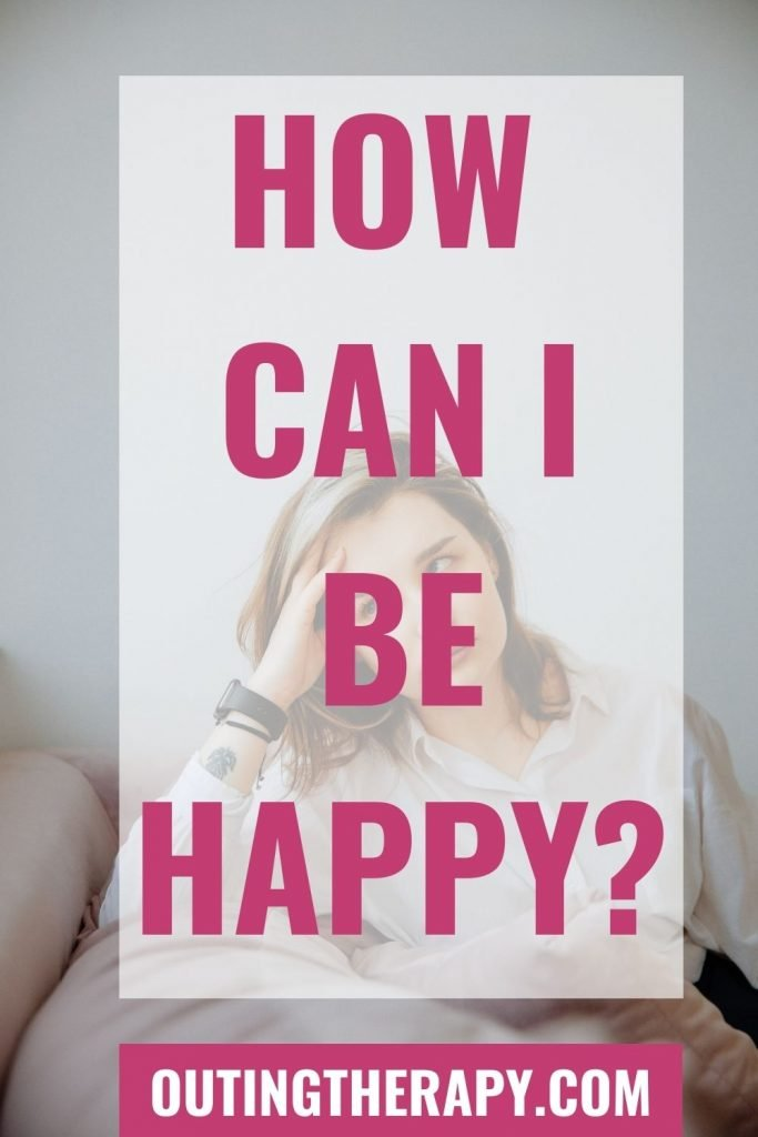 Woman unhappy sitting on a couch wondering How can I be happy?