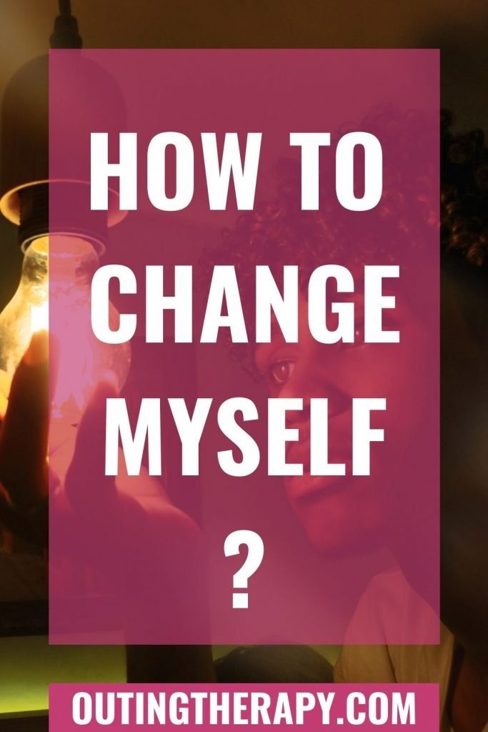 Man changing a lightbulb asking himself how to change myself