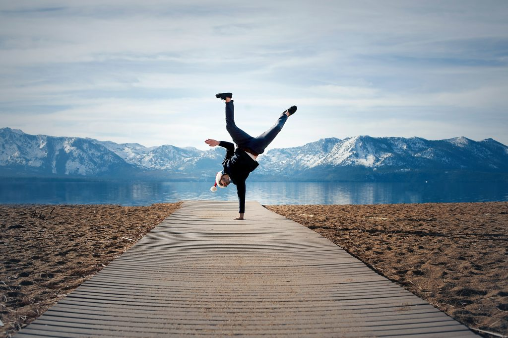 Man jumping up for joy to show the result of doing the work to change yourself
