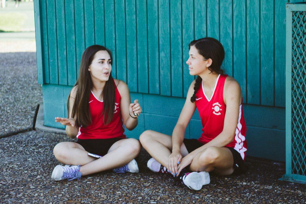 A girl telling another girl she's hurt her feelings