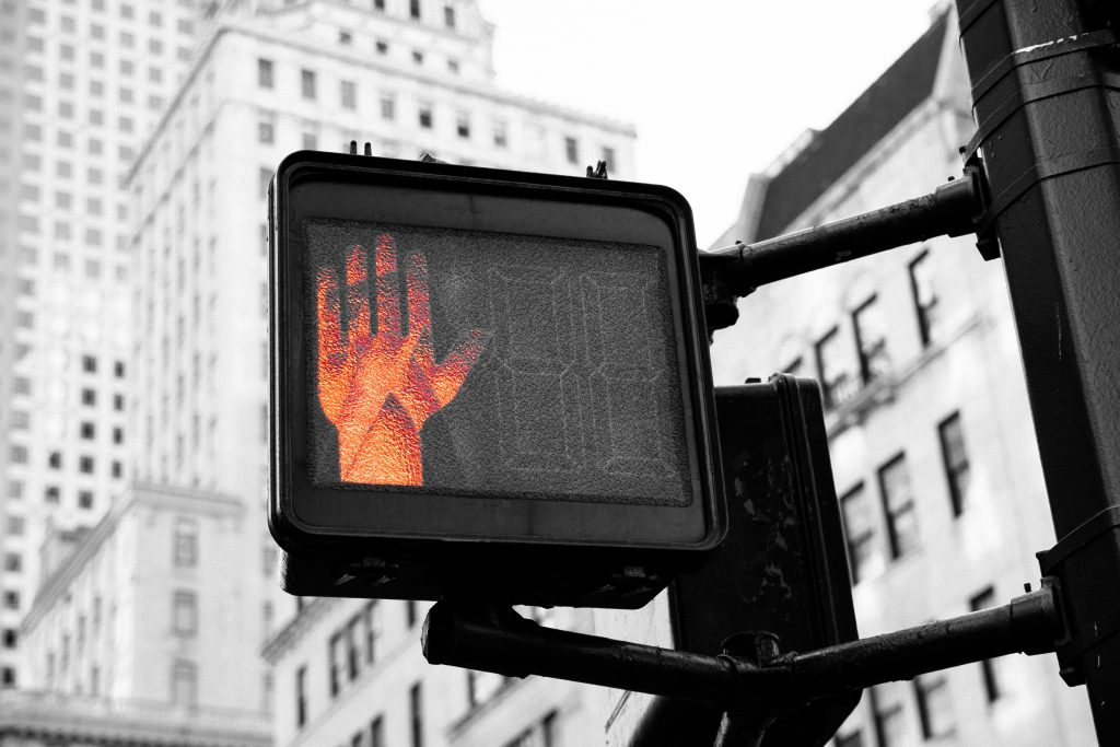Pedestrain crossing hand stop sign to allow you to pause before telling someone how they've hurt your feelings