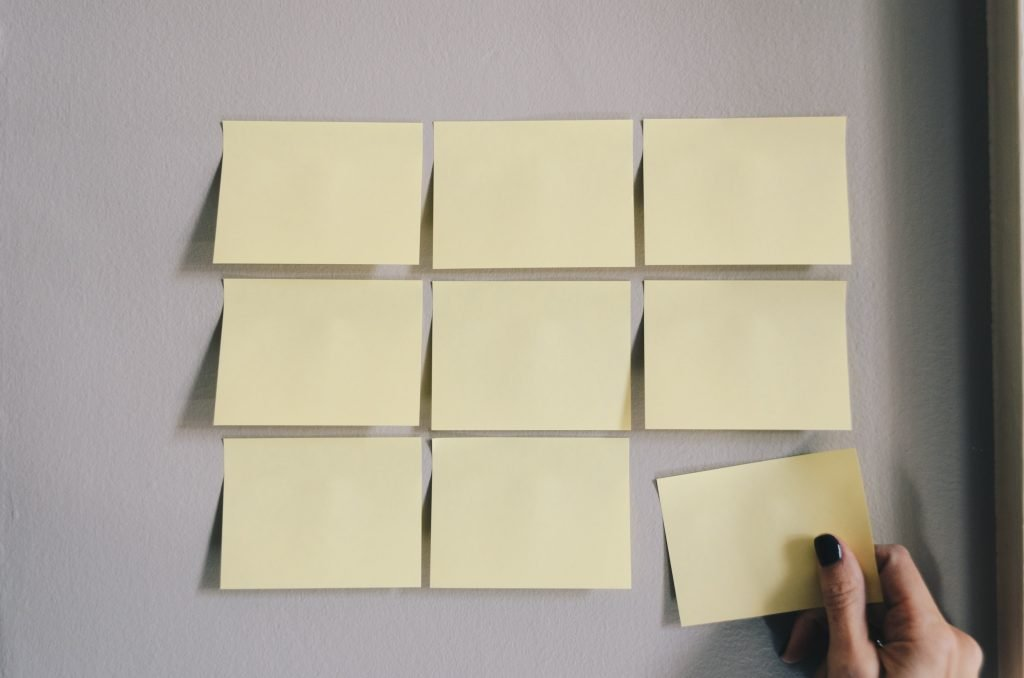 Post it notes on a wall to show the results of taking action to change the thoughts and feelings, which reinforce your hate of life