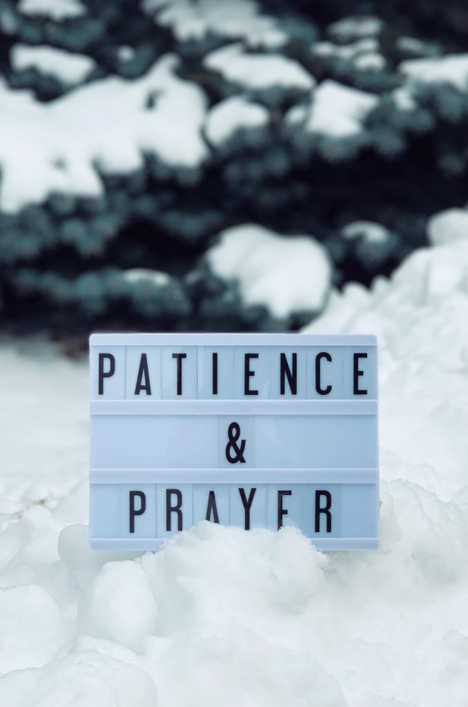 A white board in the snow with the words patience and prayer to also show how to see therapy
