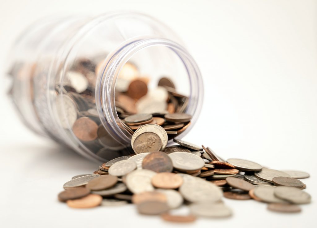 A container full of change knocked over to show the cost mindless scrolling is having on your life