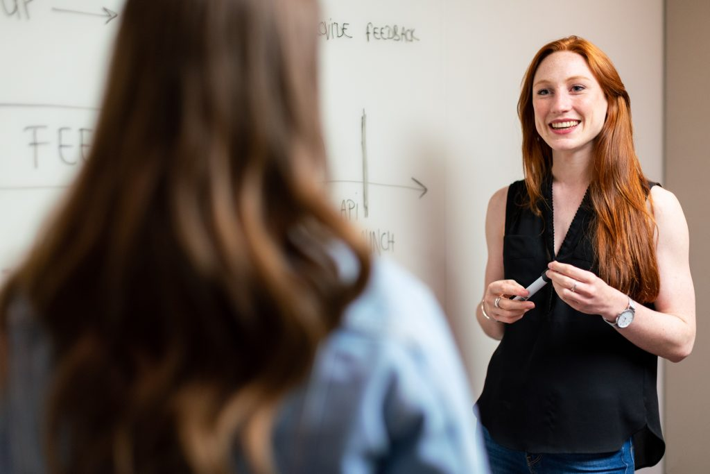 A woman teaching a student how to stop running away from problems