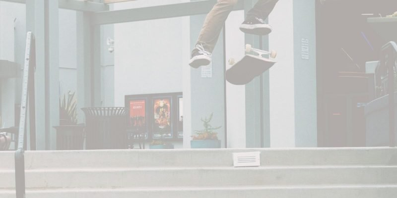 Man jumping over stairs with his skateboard in answer to the question how can I overcome my fear of change
