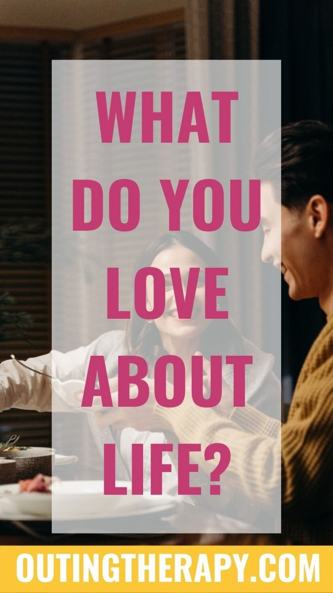A couple at a dinner table eating answering the question what do you love about life