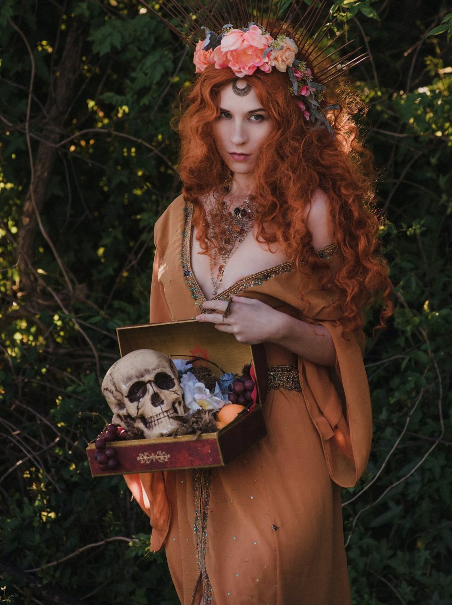 A woman in front of a bushe with a pandora's box to show healthy ways to improve your mood
